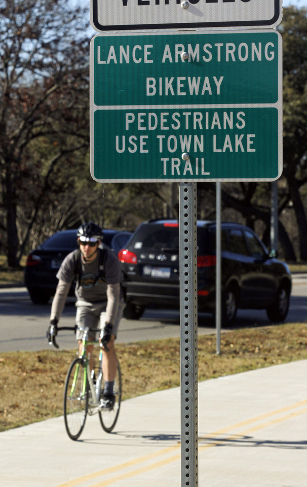 Photo - A cyclist rides along the Lance Armstrong Bikeway, Sunday, Jan. 13, 2013, in Austin, Texas. In what's been billed as a