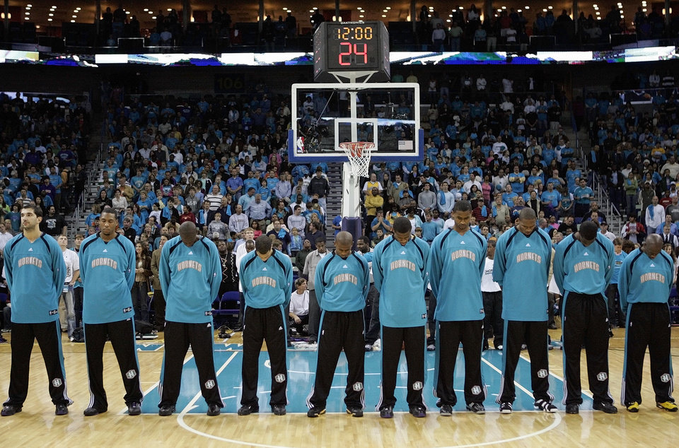 Photo - The Hornets stand during the prayer before the NBA basketball game between the New Orleans/Oklahoma City Hornets and the Houston Rockets at the New Orleans Arena Sunday, November 5, 2006, in New Orleans. By Nate Billings, The Oklahoman  ORG XMIT: KOD