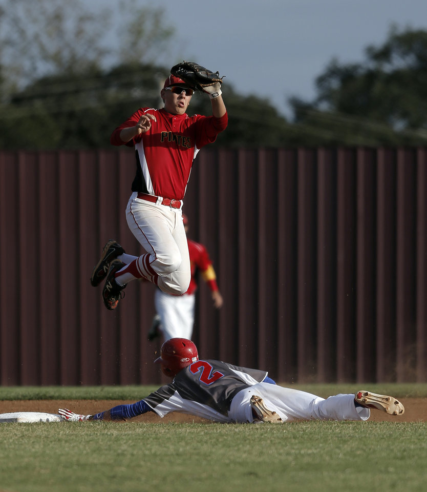 Silo's Andrew Bolin (2) slides into second base past Dale's Chase Byndas (2) during the Class A State Baseball semifinal game between Dale and Silo in Edmond, Okla., Friday, Oct. 5, 2012.  Photo by Garett Fisbeck, The Oklahoman