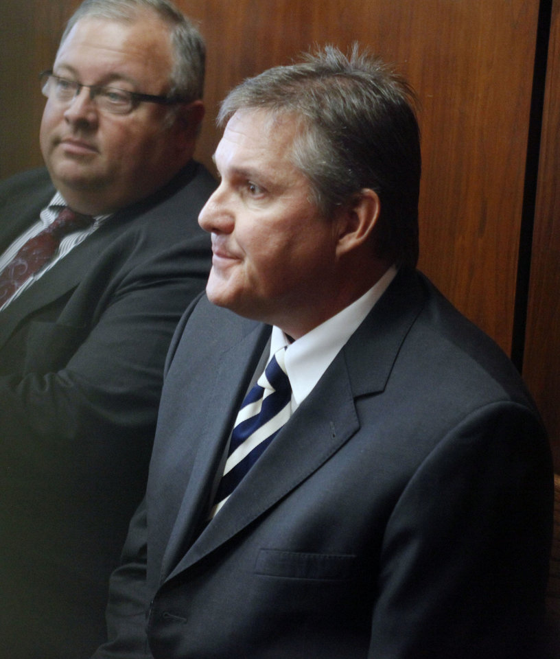 Photo - State Sen. Cliff Branan watches a preliminary hearing in a blackmail case after testifying Friday.  PAUL HELLSTERN - Oklahoman