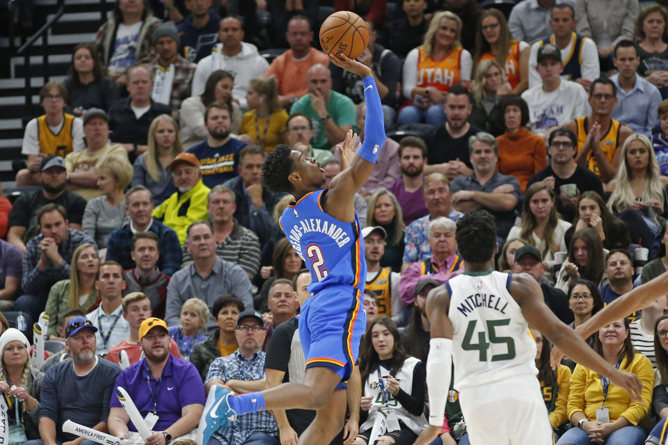 Photo - Oklahoma City Thunder guard Shai Gilgeous-Alexander (2) shoots as Utah Jazz guard Donovan Mitchell (45) watches during the second half of an NBA basketball game Wednesday, Oct. 23, 2019, in Salt Lake City. (AP Photo/Rick Bowmer)
