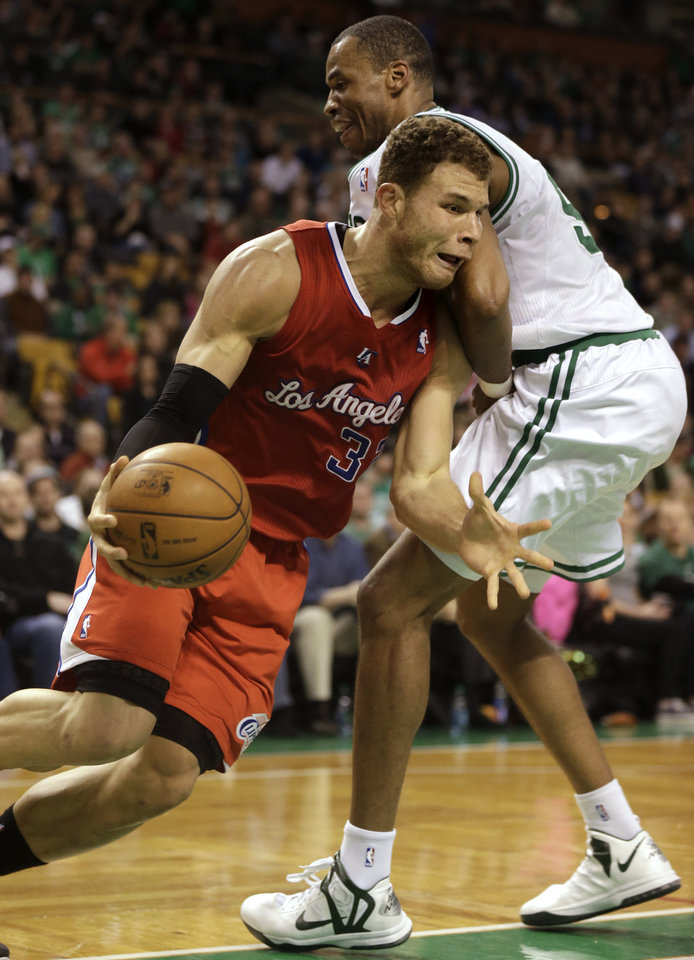 Photo - Los Angeles Clippers forward Blake Griffin, left, looks for an opening around Boston Celtics center Jason Collins, right, in the first quarter of an NBA basketball game at the TD Garden in Boston, Sunday, Feb. 3, 2013. (AP Photo/Steven Senne)