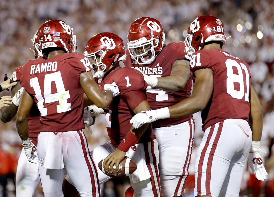 Photo - Oklahoma celebrates a Jalen Hurts touchdown in the third quarter during a college football game between the University of Oklahoma Sooners (OU) and the Houston Cougars at Gaylord Family-Oklahoma Memorial Stadium in Norman, Okla., Sunday, Sept. 1, 2019. [Sarah Phipps/The Oklahoman]