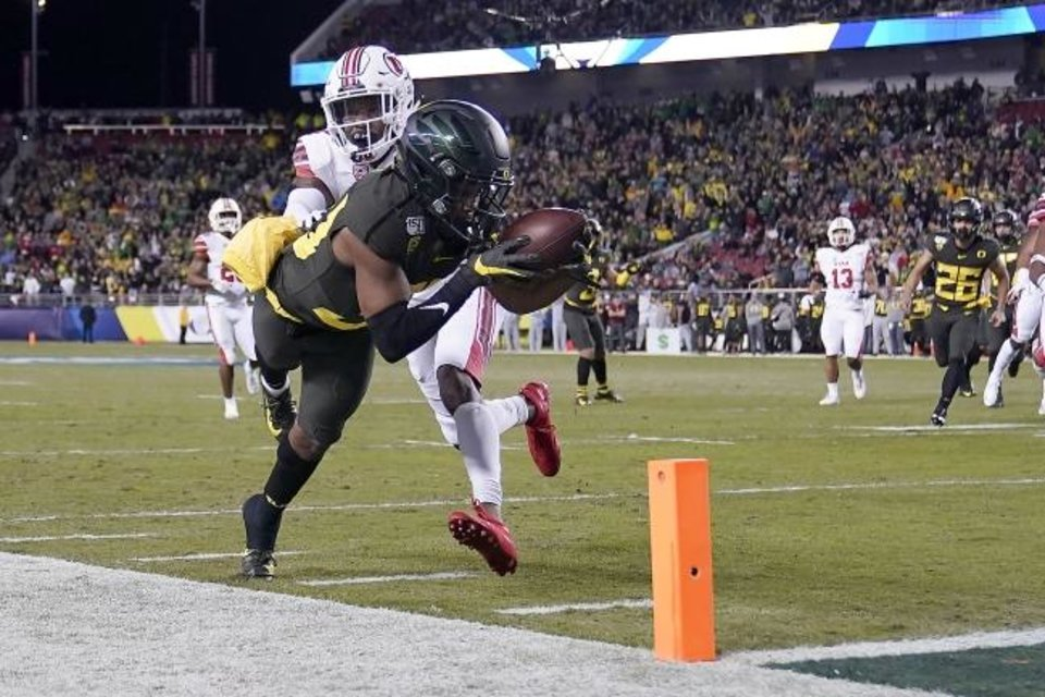 Photo -  Oregon receiver Jaylon Redd (30) is pushed out of bounds by Utah defensive back Josh Nurse (14) short of the goal line during the first half of the Pac-12 Conference championship Friday in Santa Clara, Calif. The Ducks won 37-15. Get full coverage at oklahoman.com/sports. [AP Photo/Tony Avelar]