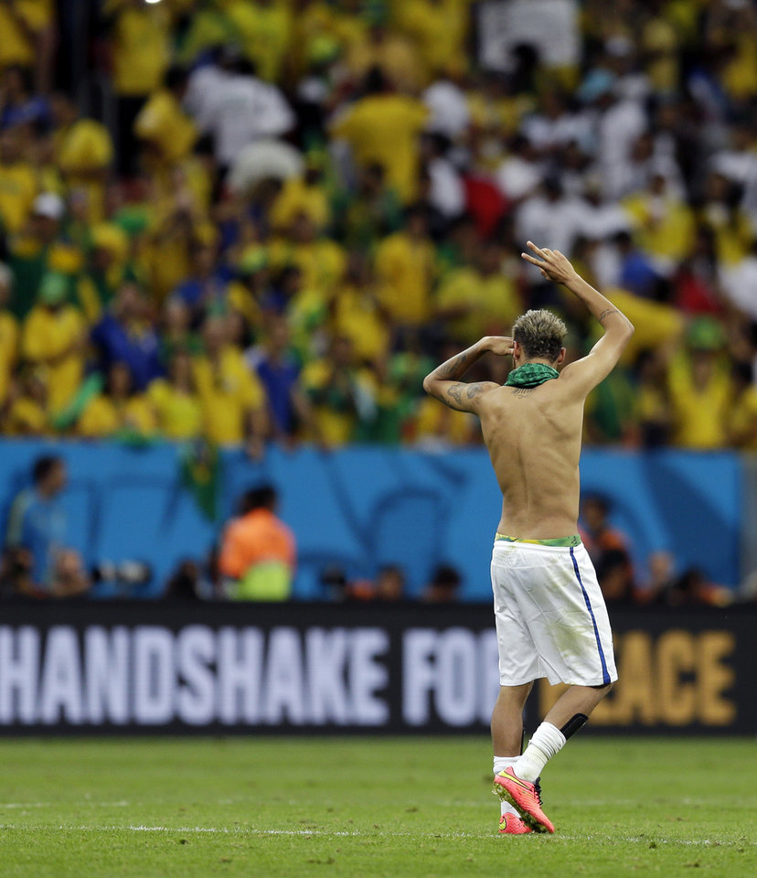 Photo - Brazil's Neymar waves to supporters following their 4-1 victory over Cameroon in the group A World Cup soccer match between Cameroon and Brazil at the Estadio Nacional in Brasilia, Brazil, Monday, June 23, 2014. (AP Photo/Natacha Pisarenko)