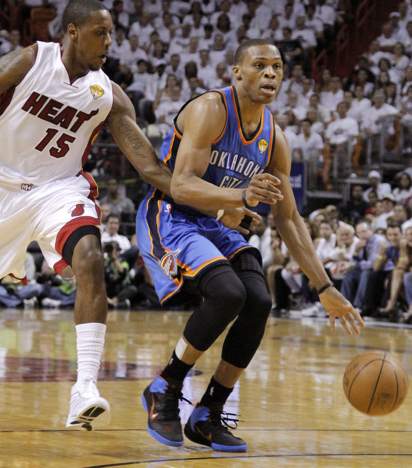 Oklahoma City's Russell Westbrook (0) goes past Miami's Mario Chalmers (15) during Game 3 of the NBA Finals between the Oklahoma City Thunder and the Miami Heat at American Airlines Arena, Sunday, June 17, 2012. Photo by Bryan Terry, The Oklahoman
