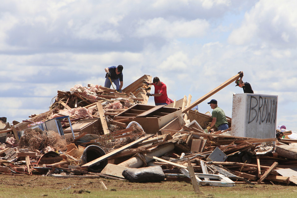 Photo - Tornado aftermath cleanup east of Piedmont, Wednesday, May 25, 2011. Family and friends help with cleanup at Chad Brown and Becky Brown's house. Photo by David McDaniel, The Oklahoman