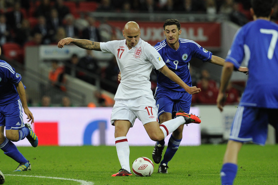 Photo -   England debutant Jonjo Shelvey, left, has a shot as he is challenged by San Marino's Michele Cervellini during their World Cup Group H qualifying soccer match at Wembley Stadium in London, Friday Oct. 12, 2012. (AP Photo/Tom Hevezi)