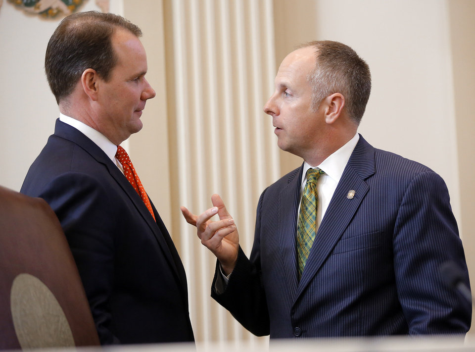 Photo - Lt. Gov. Todd Lamb, left, and Speaker of the House Jeffrey Hickman speak before the start of the Oklahoma Legislature's 2016 State-of-the-State Address by Gov. Mary Fallin in the chamber of the House of Representatives at the Oklahoma state capitol on Monday, Feb. 1, 2016, in Oklahoma City, Okla. Photo by Jim Beckel, The Oklahoman
