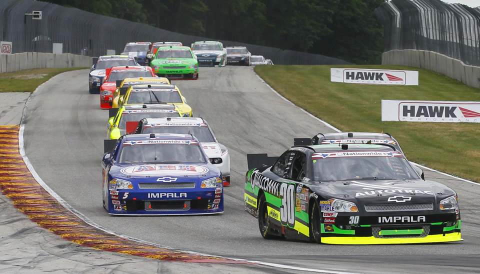 Photo -   Nelson Piquet Jr (30) leads cars through a turn during the NASCAR Nationwide Series Sargento 200 auto race at Road America in Elkhart Lake, Wis, Saturday, June, 23, 2012.son Piquet Jr. went on to win the race. (AP Photo/Jeffrey Phelps)