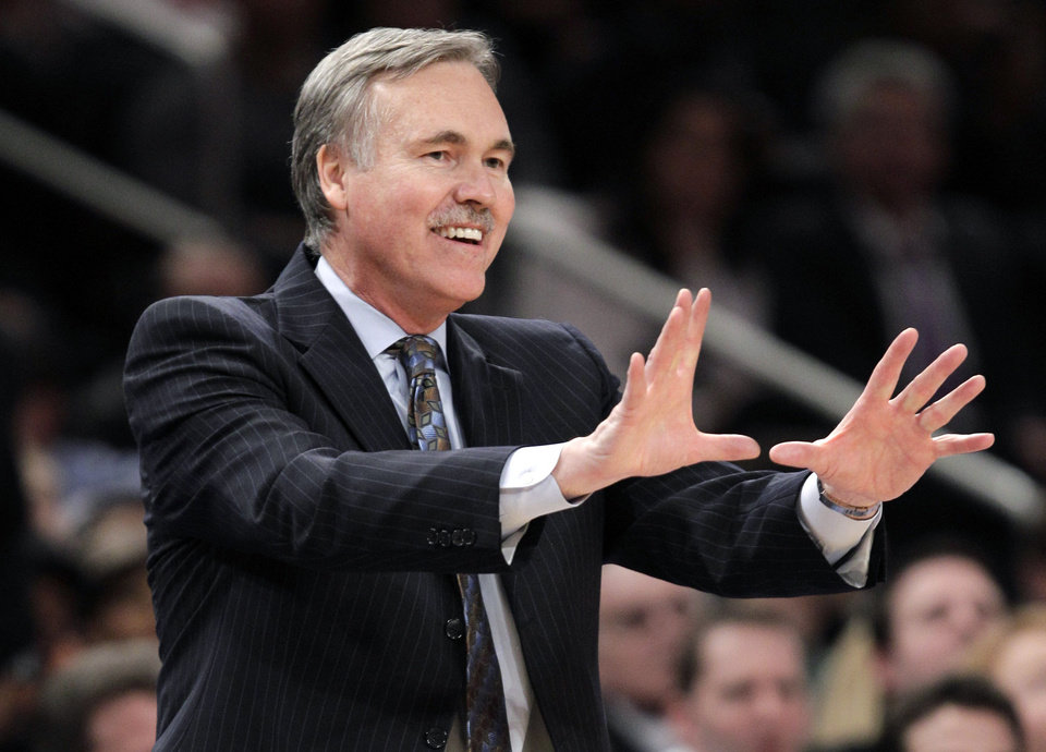 FILE - In this Feb. 22, 2012, file photo, then-New York Knicks coach Mike D\'Antoni gestures in the second half of an NBA basketball game against the Atlanta Hawks in New York. D\'Antoni\'s agent says the Los Angeles Lakers have signed the former coach of the Suns and Knicks to a four-year contract to replace Mike Brown in a deal late Sunday, Nov. 11, 2012, two days after the Lakers fired Brown five games into the season. (AP Photo/Kathy Willens, File) ORG XMIT: NY110