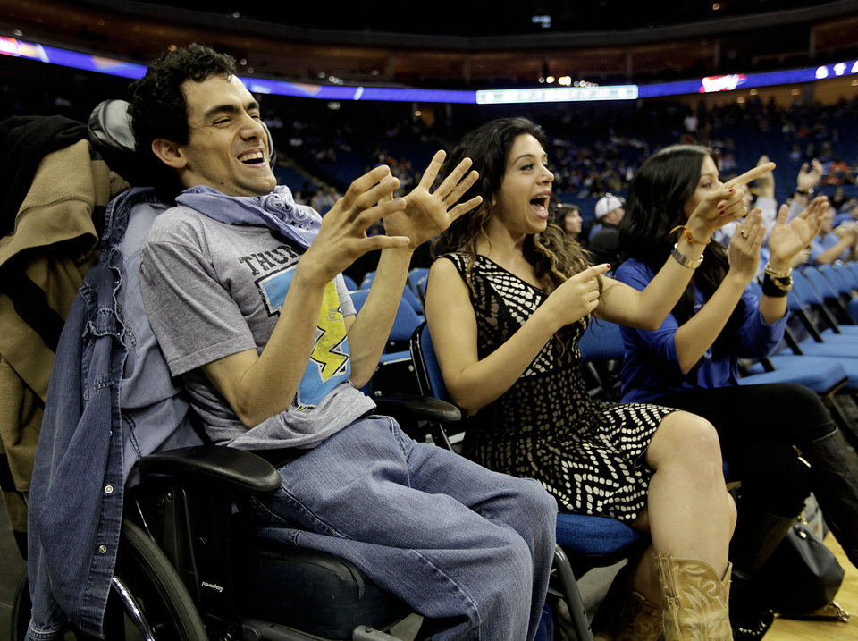 Adam Nasreddine and his sisters Rania and Jessica react as players take the floor at the Oklahoma City Thunder exhibition game against the Phoenix Suns at the BOK Center on Oct. 19, 2012. Photo by Mike Simons/Tulsa World