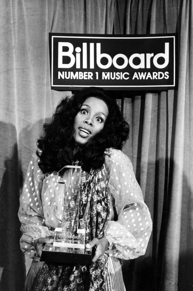 "Photo -   FILE - In this Dec. 11, 1977 file photo,Donna Summer holds her award at the Billboard Number 1 Music Awards in Santa Monica, Calif. Summer, the Queen of Disco who ruled the dance floors with anthems like ""Last Dance,"" ""Love to Love You Baby"" and ""Bad Girl,"" has died. Her family released a statement, saying Summer died Thursday, May 17, 2012. She was 63. (AP Photo/File)"