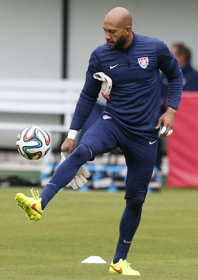 Photo - United States' goalkeeper Tim Howard controls a ball during a training session in Sao Paulo, Brazil, Thursday, June 19, 2014.  The United States will play against Portugal in group G of the 2014 soccer World Cup on June 22. (AP Photo/Julio Cortez)
