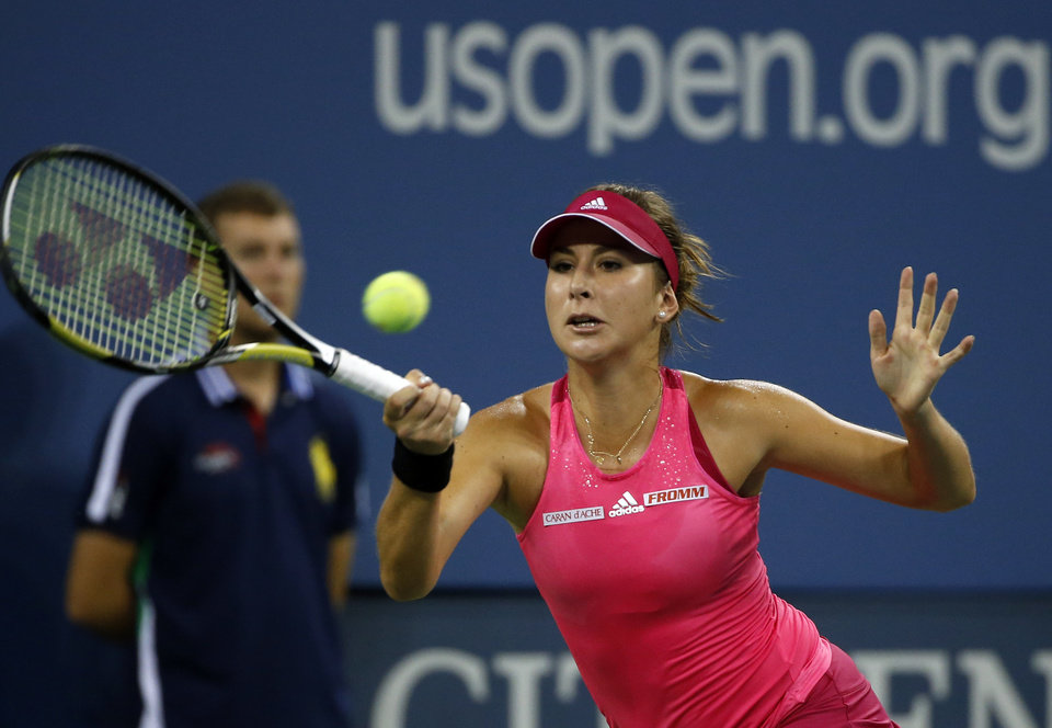 Photo - Belinda Bencic, of Switzerland, returns to Jelena Jankovic, of Serbia, during their match in the fourth round of the 2014 U.S. Open tennis tournament, Sunday, Aug. 31, 2014, in New York. (AP Photo/Elise Amendola)