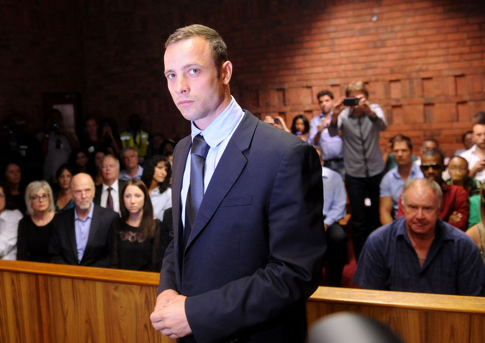 Photo - Olympic athlete, Oscar Pistorius , in court Friday Feb. 22, 2013 in Pretoria, South Africa, for his bail hearing charged with the shooting death of his girlfriend, Reeva Steenkamp. The defense and prosecution both completed their arguments with the magistrate soon to rule if the double-amputee athlete can be freed before trial or if he must stay behind bars pending trial. (AP Photo/Antoine de Ras-Star) SOUTH AFRICA OUT