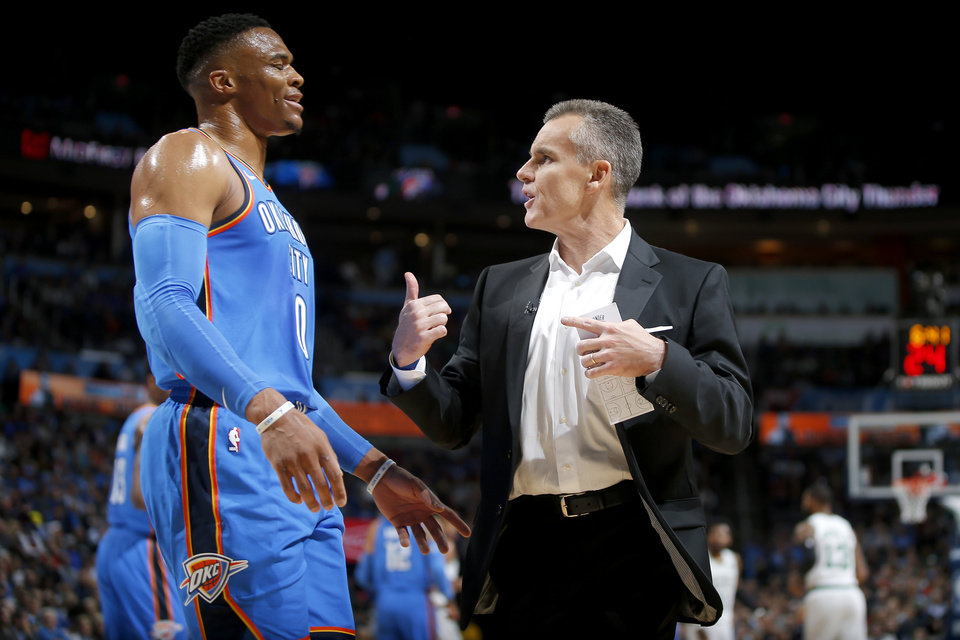 Photo - Oklahoma City's Russell Westbrook (0) talks with Oklahoma City coach Billy Donovan during an NBA basketball game between the Oklahoma City Thunder and the Boston Celtics at Chesapeake Energy Arena in Oklahoma City, Thursday, Oct. 25, 2018. Photo by Bryan Terry, The Oklahoman