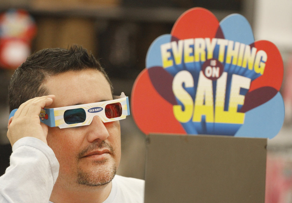 Photo - Jerry Luna uses 3D glasses to find bargains during Gobble Palooza at Old Navy on South Pennsylvania in Oklahoma City, Thursday November, 24,  2011. Oklahoman Photo by Steve Gooch