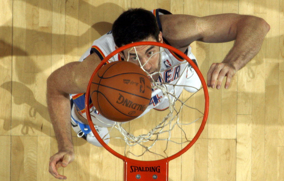 Photo - Oklahoma City's Nick Collison (4) makes a basket during the NBA basketball game between the Oklahoma City Thunder and the Phoenix Suns, Sunday, Dec. 19, 2010, at the Oklahoma City Arena. Photo by Sarah Phipps, The Oklahoman