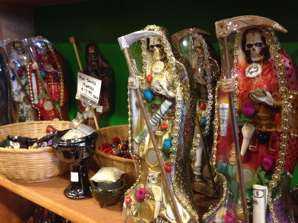 FILE - In this Feb. 13, 2013 file photo, statues of La Santa Muerte are shown at the Masks y Mas art store in Albuquerque, N.M.  The Vatican's culture minister said in Mexico City on Wednesday, May 8, 2013 that Mexico's folk Death Saint is a blasphemous symbol that shouldn't be part of any religion.  La Santa Muerte is worshipped both by drug dealers in Mexico and by the terrified people who live in drug-torn neighborhoods. (AP Photo/Russell Contreras, File)