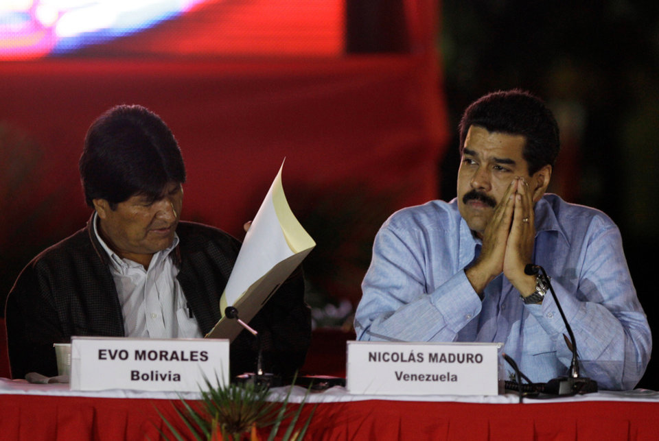 Venezuela's Vice President Nicolas Maduro, right, and Bolivia's President Evo Morales attend the 8th anniversary of ALBA group in Caracas, Venezuela, Saturday, Dec. 15, 2012. President Hugo Chavez has been receiving daily visits from former Cuban leader Fidel Castro while recovering from cancer surgery in Cuba, a Venezuelan government official said Saturday night. (AP Photo/Fernando Llano)