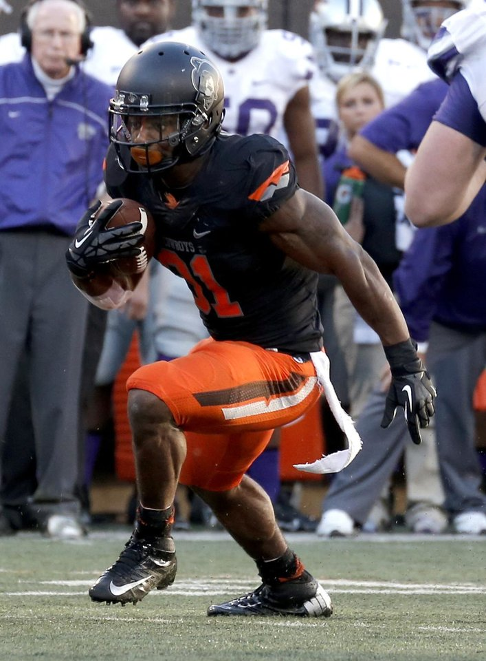 Oklahoma State's Jeremy Smith (31) rushes during the second half of a college football game between the Oklahoma State University Cowboys (OSU) and the Kansas State University Wildcats (KSU) at Boone Pickens Stadium in Stillwater, Okla., Saturday, Oct. 5, 2013. OSU won 33-29.Photo by Sarah Phipps, The Oklahoman