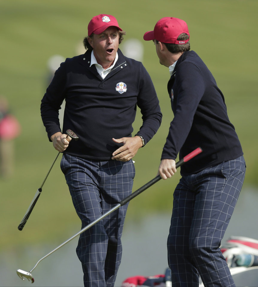 Photo -   USA's Phil Mickelson and Keegan Bradley celebrate after winning their foursomes match on the 15th hole at the Ryder Cup PGA golf tournament Friday, Sept. 28, 2012, at the Medinah Country Club in Medinah, Ill. (AP Photo/Charlie Riedel)