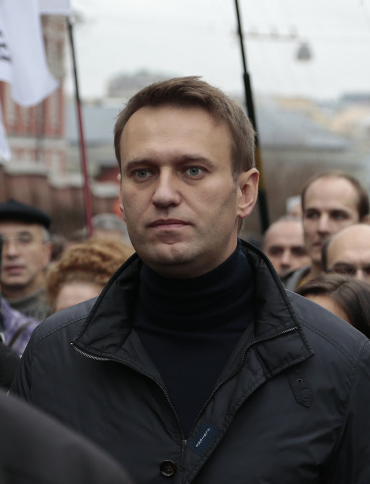 Photo - FILE - In this Sunday, Oct. 27, 2013 file photo Russian opposition leader Alexei Navalny takes part in an opposition rally in downtown Moscow. Russia's anti-corruption campaigner Navalny on Monday, Jan. 27, 2014, launched a website to publish a wide range of data pointing to corruption in Sochi. Russia has spent about $51 billion to deliver the Winter Olympics in Sochi, which run Feb. 7-23. (AP Photo/Ivan Sekretarev, File)
