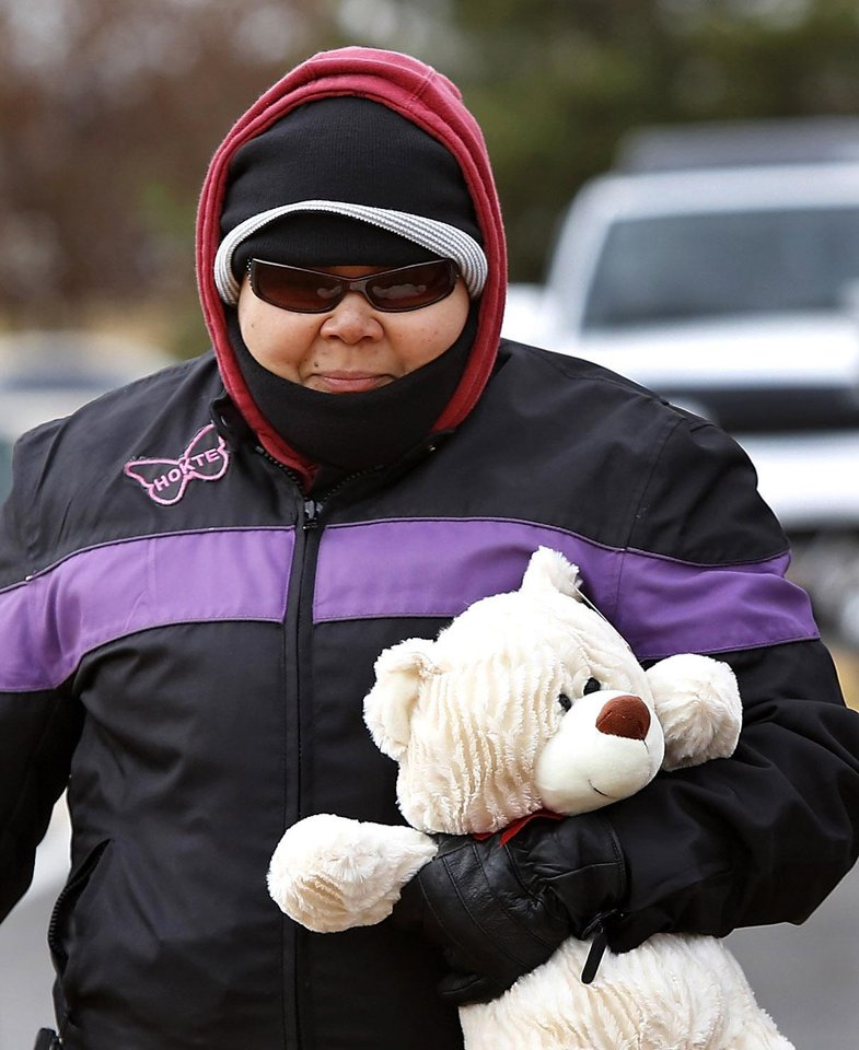 Serena Selumber of Shawnee, carries a stuffed animal to donate to the toy drive.  She and three friends, all members of the Oklahoma Indian Bikers Motorcycle Club, participated in the charity ride because they wanted to  support the motorcycle clubs and help children by donating gifts to the toy collection. About 300 motorcycle riders participated in a charity ride in southwest Oklahoma City on Sunday afternoon, Dec. 9, 2012. Escorted by Oklahoma City police motorcycle units, the bikers traveled along SW 29 Street, S. Western, SW 44 Street and returned to Woodson Park at SW 36 and S. May Avenue.  Feed The Children and the Fellowship of Christian Bikers sponsored the motorcycle ride/toy drive.   Photo by Jim Beckel, The Oklahoman