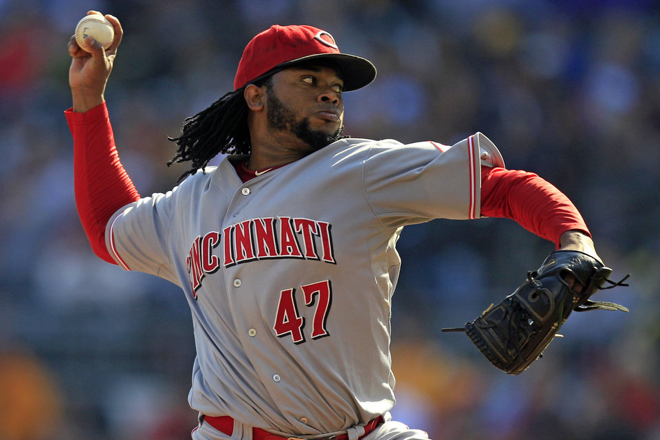 Cincinnati Reds starting pitcher Johnny Cueto (47) delivers during the fifth inning of a baseball game against the Pittsburgh Pirates in Pittsburgh Sunday, Sept. 30, 2012. The Reds won 4-3, with Cueto not figuring in the decision. (AP Photo/Gene J. Puskar)