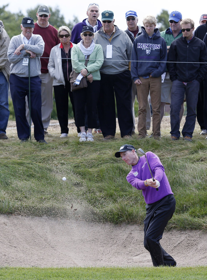 Photo - Jim Furyk hits out of the sand on the third hole during the final round of the BMW Championship golf tournament at Conway Farms Golf Club in Lake Forest, Ill., Monday, Sept. 16, 2013. (AP Photo/Charles Rex Arbogast)