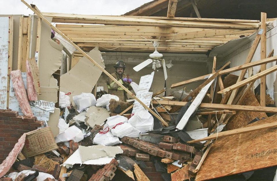 Andrew Ridnour salvages items from his home  in East Limestone County, Ala., on  Friday. March 2, 2012.  A reported tornado destroyed several houses in northern Alabama as storms threatened more twisters across the region Friday  (AP Photo/The Huntsville Times, Robin Conn)   ORG XMIT: ALHUT116