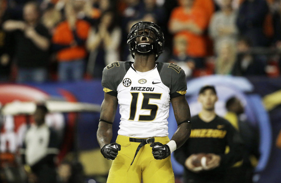 Photo - In this Dec. 7, 2013, file photo, Missouri wide receiver Dorial Green-Beckham celebrates his touchdown against Auburn during the first half of the Southeastern Conference NCAA college football championship game in Atlanta. Dorial Green-Beckham was suspended indefinitely Monday, April 7, 2014, for an unspecified violation of team rules, three months after he and two friends were arrested on suspicion of felony drug distribution when police found a pound of marijuana in their car. Coach Gary Pinkel announced the suspension without mentioning the January incident in which the standout receiver was arrested in his Missouri hometown of Springfield. (AP Photo/John Bazemore, File)