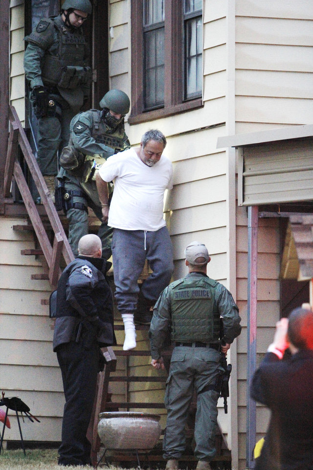 Photo - Agents with the Oklahoma Bureau of Narcotics and Dangerous Drugs Control and local law enforcement arrest Larry Downs at an apartment at 2409 N Drexel in Oklahoma City. Photo by Paul B. Southerland, The Oklahoman  PAUL B. SOUTHERLAND
