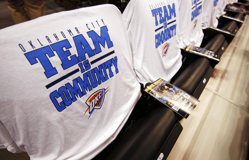 Photo - T-shirts sit on chairs in the arena before Game 2 of the first round in the NBA playoffs between the Oklahoma City Thunder and the Dallas Mavericks at Chesapeake Energy Arena in Oklahoma City, Monday, April 30, 2012. Photo by Nate Billings, The Oklahoman