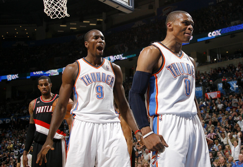 Photo - Oklahoma City's Russell Westbrook (0) and Serge Ibaka (9) celebrate a basket  during the NBA game between the Oklahoma City Thunder and the Portland Trailblazers, Sunday, March 27, 2011, at the Oklahoma City Arena. Photo by Sarah Phipps, The Oklahoman