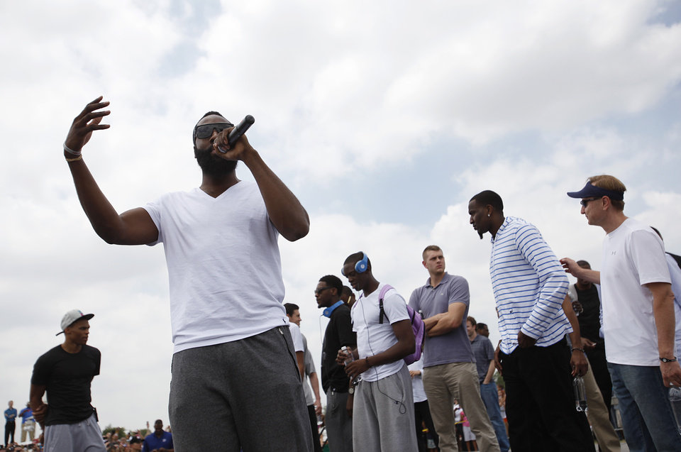 Photo - James Harden talks to a crowd of Oklahoma City Thunder fans during a welcome home rally for the Oklahoma City Thunder at a field near Will Rogers Airport in Oklahoma City, Friday, June 22, 2012.  Photo by Garett Fisbeck, The Oklahoman