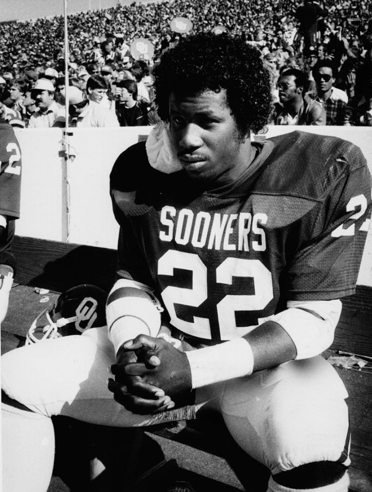 Photo - OU tailback Marcus Dupree rests on the sidelines with an icepack for his sore neck. Photo dated Nov. 6, 1982. Photo by Jim Argo, The Oklahoman ORG XMIT: KOD