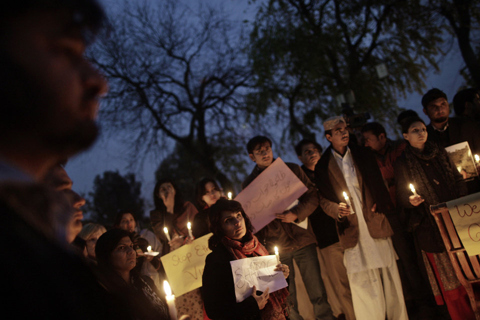 Pakistanis hold banners and candles during a protest to condemn Thursday's deadly bombings in Quetta, in Islamabad, Pakistan, Friday, Jan. 11, 2013. Shiites in a southwestern Pakistani city hit by a brutal terror attack refused to bury their dead Friday in protest, demanding that the government do something to protect them from what has become a barrage of bombings and shootings against the minority Muslim sect. (AP Photo/Muhammed Muheisen)