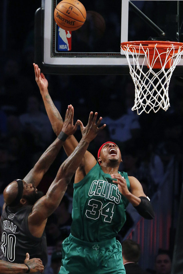 Boston Celtics forward Paul Pierce (34) shoots over Brooklyn Nets forward Reggie Evans (30) in the first half of their NBA basketball game at the Barclays Center, Tuesday, Dec. 25, 2012, in New York. (AP Photo/John Minchillo)