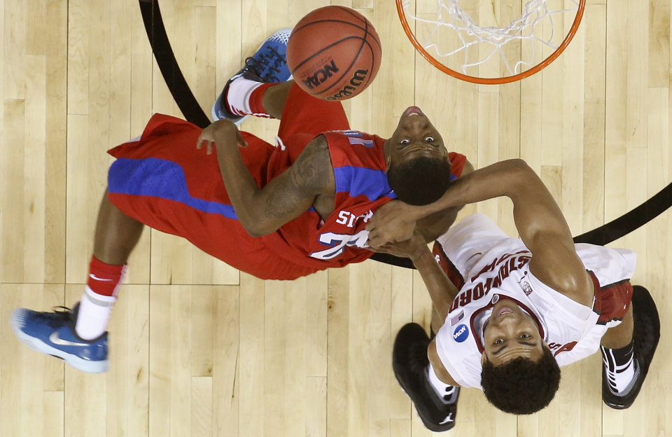 Photo - Dayton guard Jordan Sibert (24) shoots as Stanford forward Josh Huestis (24) looks on during the first half in a regional semifinal game at the NCAA college basketball tournament, Thursday, March 27, 2014, in Memphis, Tenn. (AP Photo/John Bazemore)