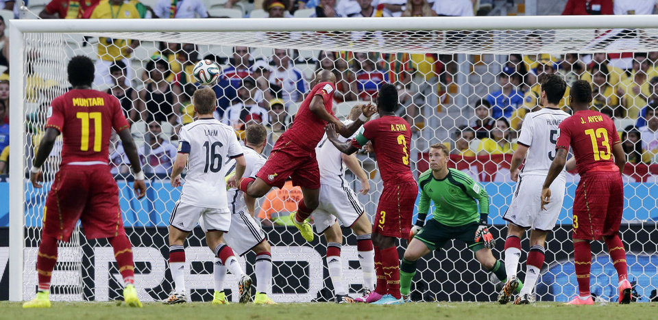 Photo - Ghana's Andre Ayew, center, scores his side's first goal during the group G World Cup soccer match between Germany and Ghana at the Arena Castelao in Fortaleza, Brazil, Saturday, June 21, 2014. (AP Photo/Matthias Schrader)