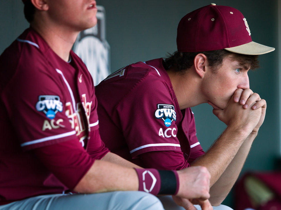 Photo -   Florida State starting pitcher Brandon Leibrandt, right, watches the end of the game from the dugout as Arizona wins 10-3 in the NCAA College World Series baseball game on Thursday, June 21, 2012, in Omaha, Neb. (AP Photo/Omaha World-Herald, Rebecca S. Gratz)  MAGS OUT. ALL LOCAL TV OUT