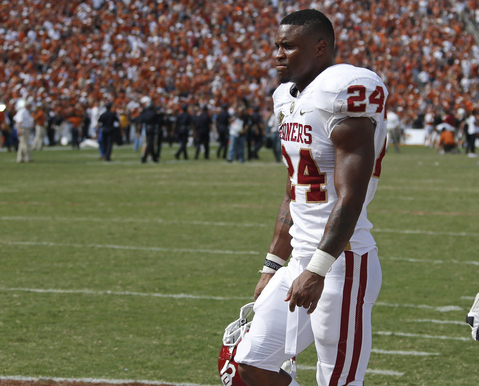 OU's Brennan Clay (24) walks off the field after the Red River Rivalry college football game between the University of Oklahoma Sooners and the University of Texas Longhorns at the Cotton Bowl Stadium in Dallas, Saturday, Oct. 12, 2013. Texas won 36-20. Photo by Bryan Terry, The Oklahoman