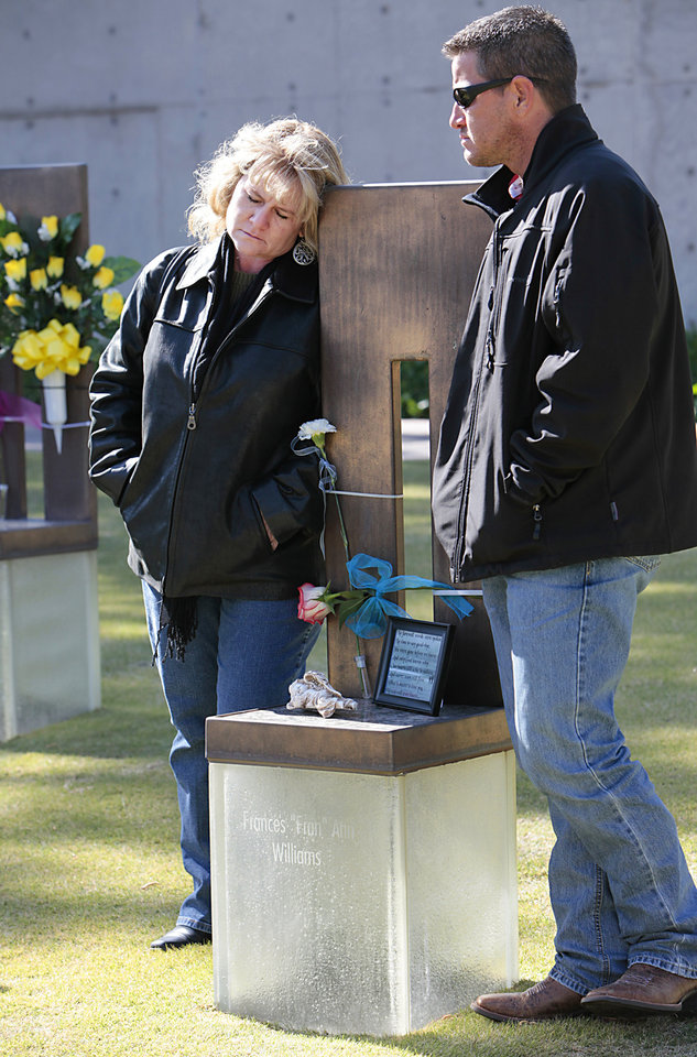 Dawn Mahon and her brother Matt Story at their mother Frances Williams\' chair during the 18th Anniversary Remembrance Ceremony at the Oklahoma City National Memorial and Museum, Friday, April 19, 2013. Photo By David McDaniel/The Oklahoman