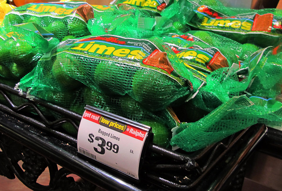 Photo - This Saturday, April 26, 2014, photo shows limes on sale for $3.99 for a 1-pound bag at a Ralphs market in Los Angeles. The lime, that humble little fruit that sort of resembles a green golf ball, has skyrocketed in price in recent weeks, quadrupling or, in some areas, going even higher. (AP Photo/Reed Saxon)