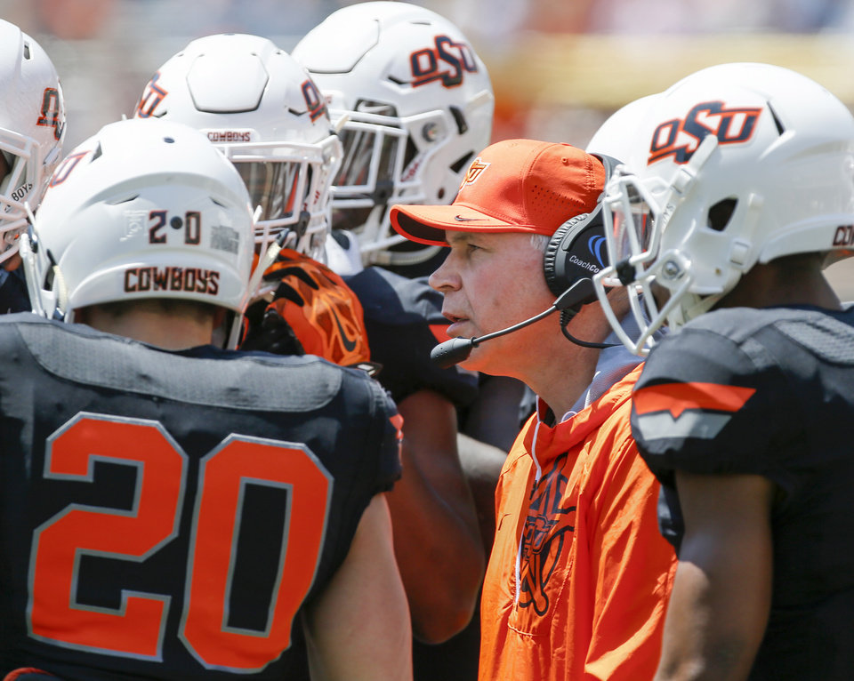 Photo - OSU defensive coordinator Jim Knowles talks to players during the spring football game for the Oklahoma State Cowboys at Boone Pickens Stadium in Stillwater, Okla., Saturday, April 28, 2018. Photo by Nate Billings, The Oklahoman