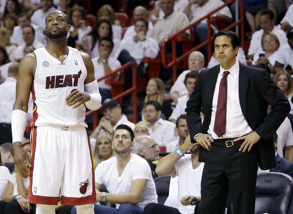 Photo - Miami Heat guard Dwyane Wade (3) and head coach Erik Spoelstra look up towards the scoreboard during the first half of Game 1 in their NBA basketball Eastern Conference finals playoff series against the Indiana Pacers, Wednesday, May 22, 2013 in Miami. (AP Photo/Lynne Sladky)
