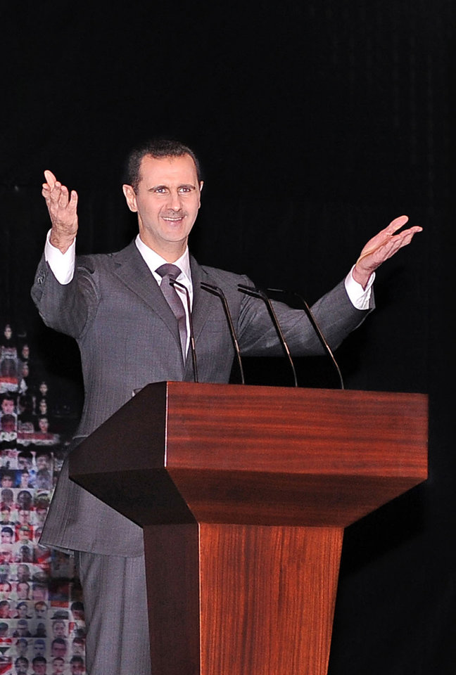 In this photo released by the Syrian official news agency SANA, Syrian President Bashar Assad gestures as he speaks, at the Opera House in central Damascus, Syria, Sunday, Jan. 6, 2013. Syrian President Bashar Assad on Sunday outlined a new peace initiative that includes a national reconciliation conference and a new government and constitution but demanded regional and Western countries stop funding and arming rebels first. (AP Photo/SANA)