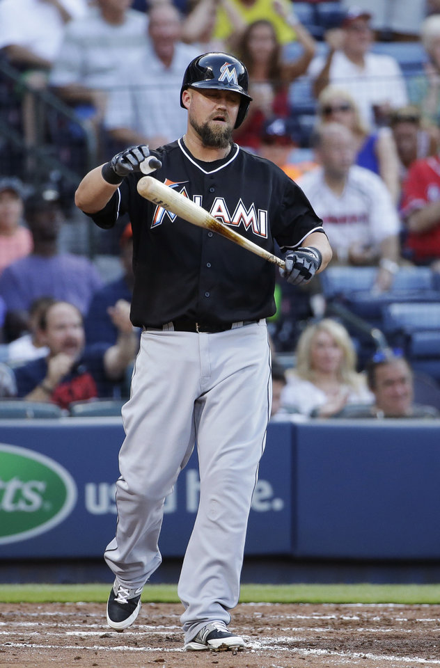 Photo - Miami Marlins' Casey McGehee reacts after striking out with the bases loaded in the sixth inning of a baseball game against the Atlanta Braves, Sunday, Aug. 31, 2014, in Atlanta. (AP Photo/David Goldman)